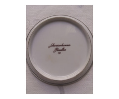 Schwarzenhammer porcelán tányér, ón keretben.