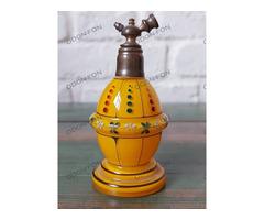Sárga parfümös üveg